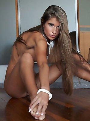 Stunning Nessa flaunts her amazing naked body on the floor.