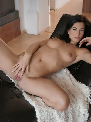 Brunette hottie Lauren enjoys a slow massage of her horny body before fondling her clit and finger fucking her bald twat