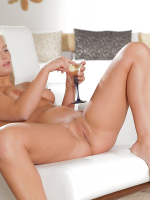 A chilled glass of champagne draws out the desire in busty blonde Marry Queen and sets her on a path to self-seduction